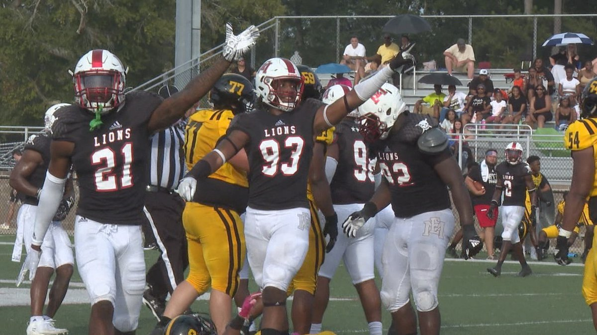 Lion defense celebrates fumble recovery to help lead EMCC to their 34-19 victory.