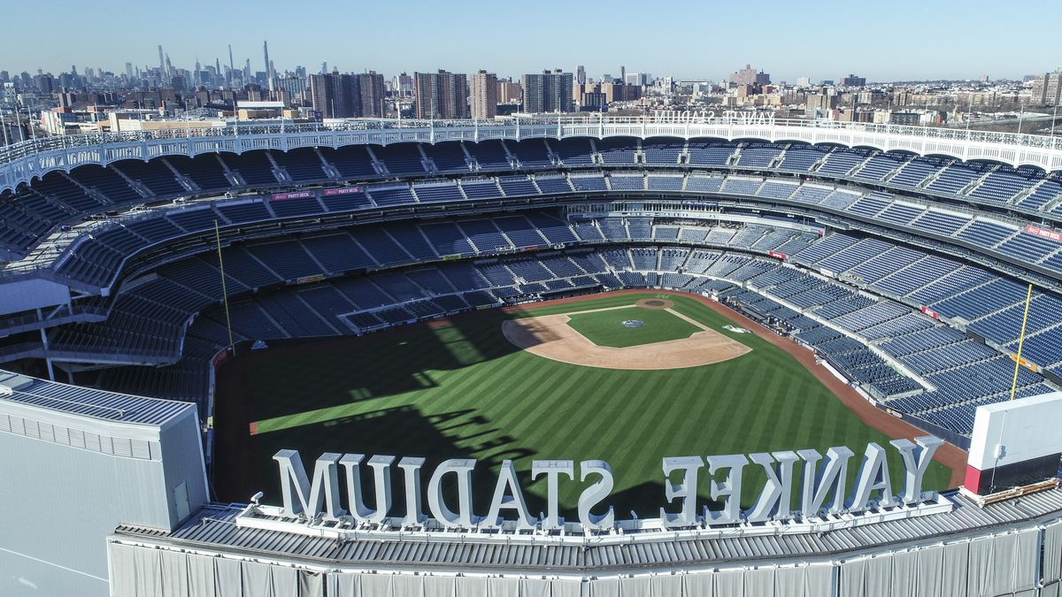 This March 26, 2020 file photo shows an empty Yankee Stadium on opening day due to COVID-19...