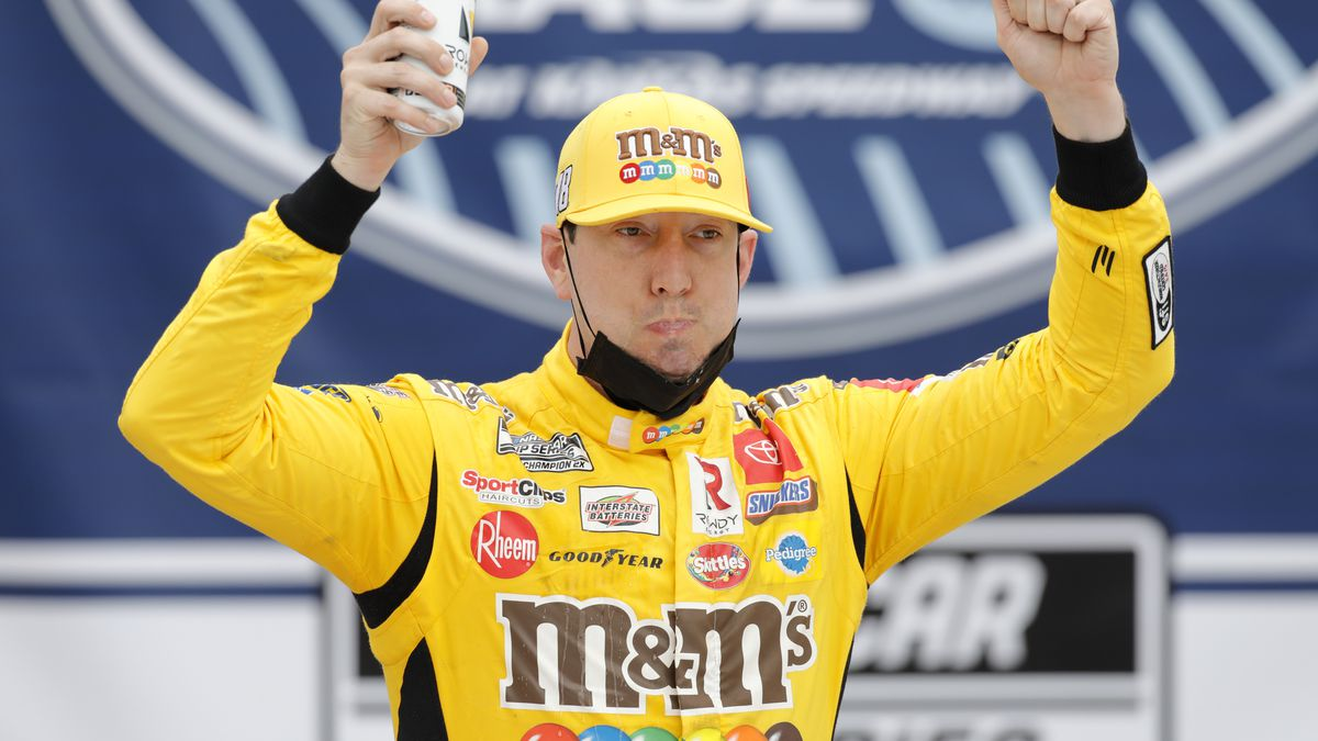 Kyle Busch celebrates in Victory Lane after winning a NASCAR Cup Series auto race at Kansas...