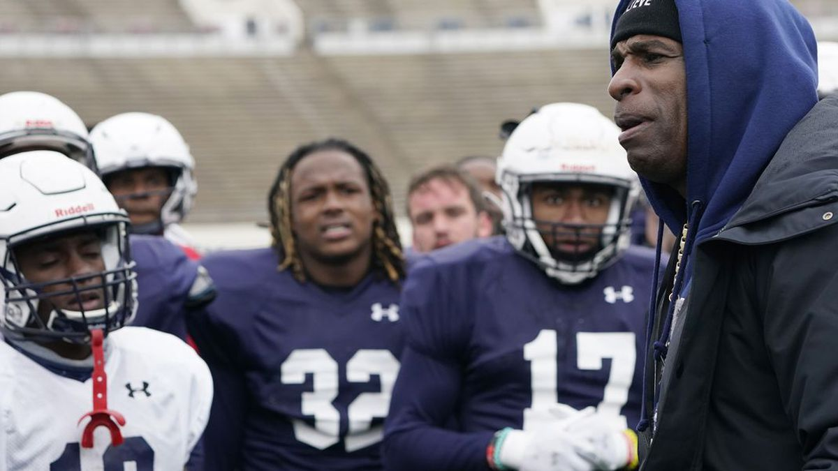 Jackson State football coach Deion Sanders speaks with players following an NCAA college...