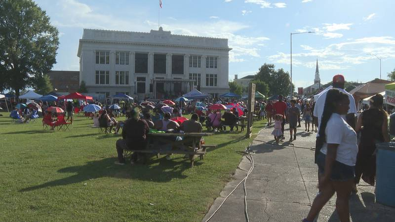 The city hall lawn is packed with hundreds of people celebrating the annual Juneteenth Heritage...