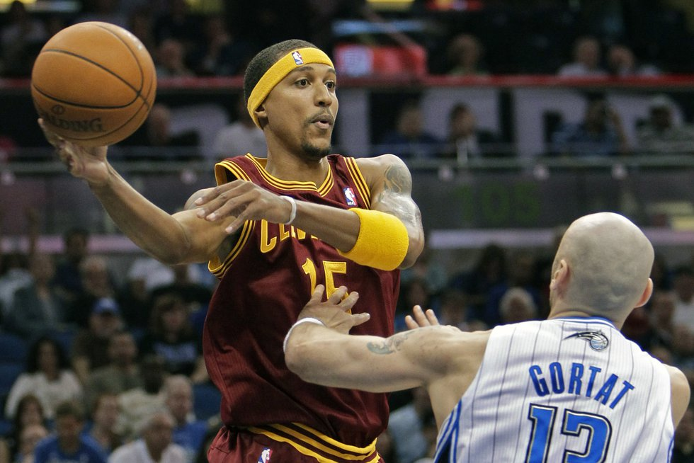 FILE - Cleveland Cavaliers' Jamario Moon, left, makes a pass over the head of Orlando Magic's...