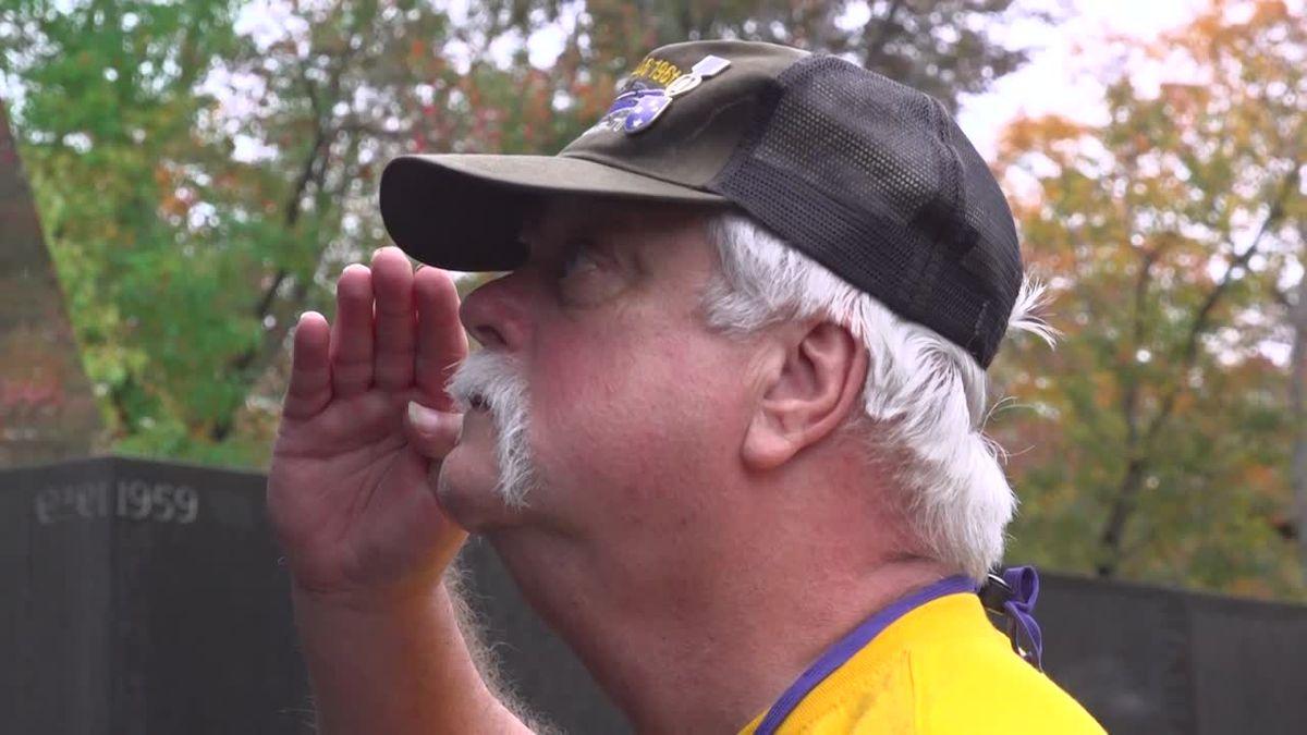 Veteran David Woods salutes his friends' names on the Vietnam Veterans' Memorial in Washington, D.C (Source: Gray DC).