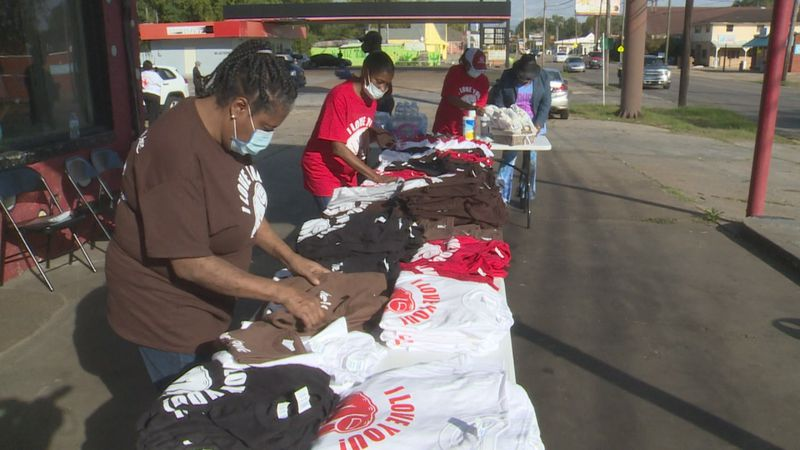 "A local group gave away over 150 free t-shirts that say ""I love you"" and ""treat me like you..."