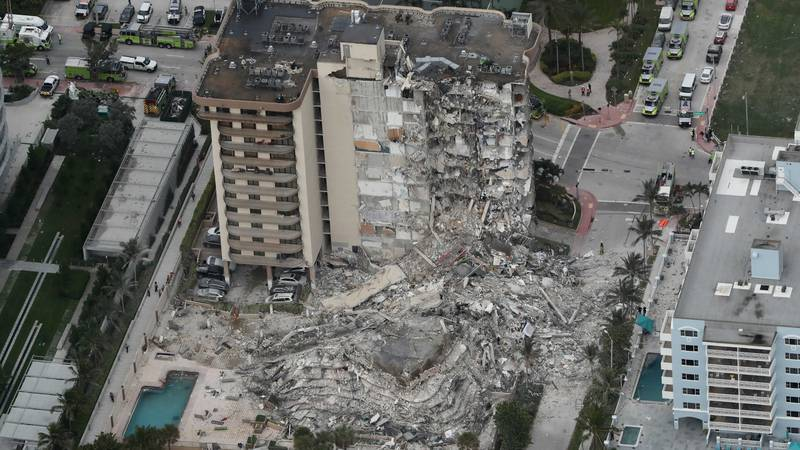 This aerial photo shows part of the 12-story oceanfront Champlain Towers South Condo that...