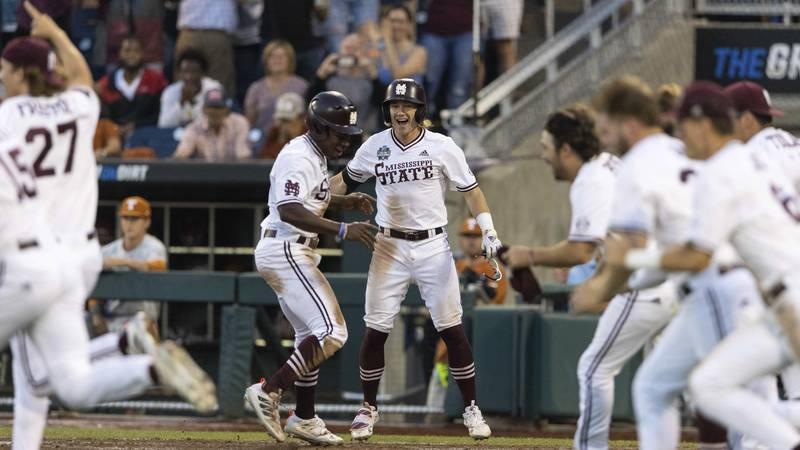 Mississippi State's Brayland Skinner, center, reacts after scoring the walk-off run against...