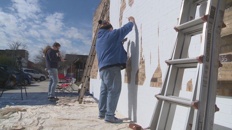 Local artists got together to begin a bright and colorful project dedicated to one of...