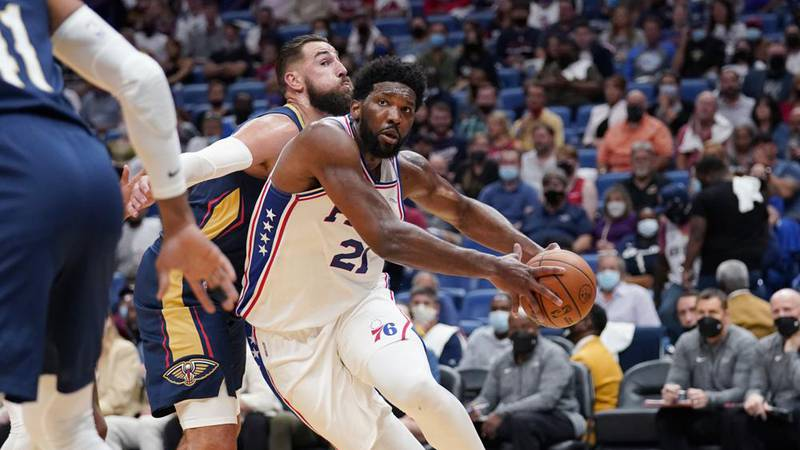 Philadelphia 76ers center Joel Embiid (21) drives to the basket against New Orleans Pelicans...