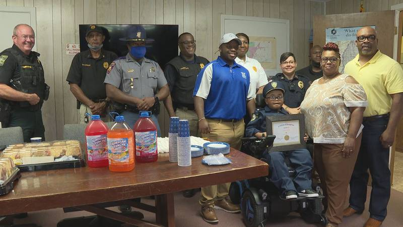 LaDarius Spivey is joined by members of local law enforcement to celebrate his 11th birthday.