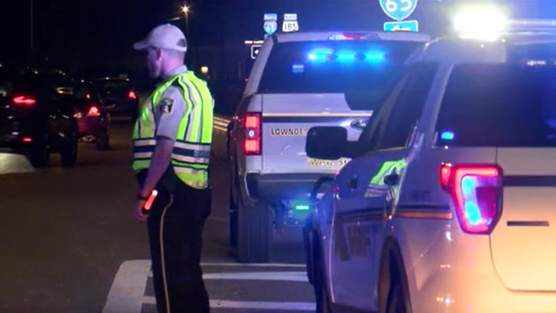 A law enforcement office redirects traffic hours after a multi-fatal crash shut down Interstate...
