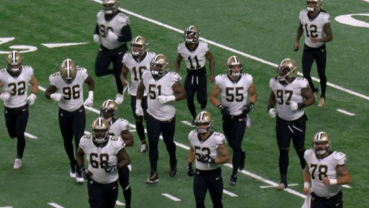 New Orleans Saints players enter the field together