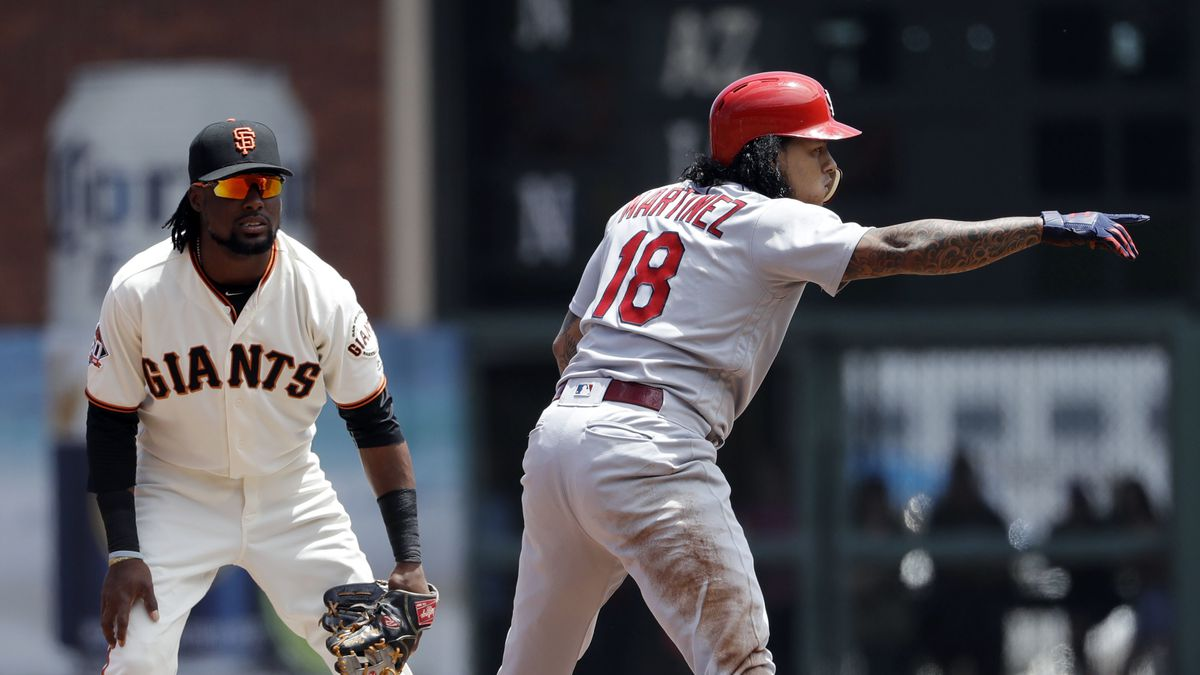 St. Louis Cardinals' Carlos Martinez (18) points to the dugout after driving in a run with a double during the third inning of a baseball game against the San Francisco Giants, Saturday, July 7, 2018, in San Francisco. (AP Photo/Marcio Jose Sanchez)