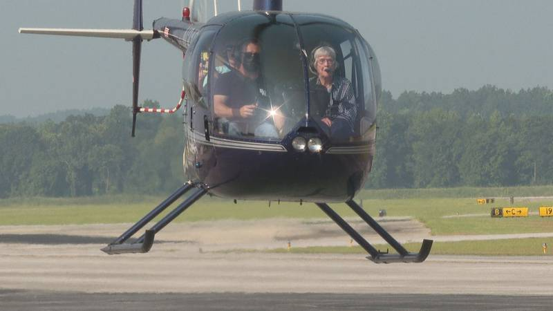 Pauline Grace rides in a helicopter for her 100th birthday.