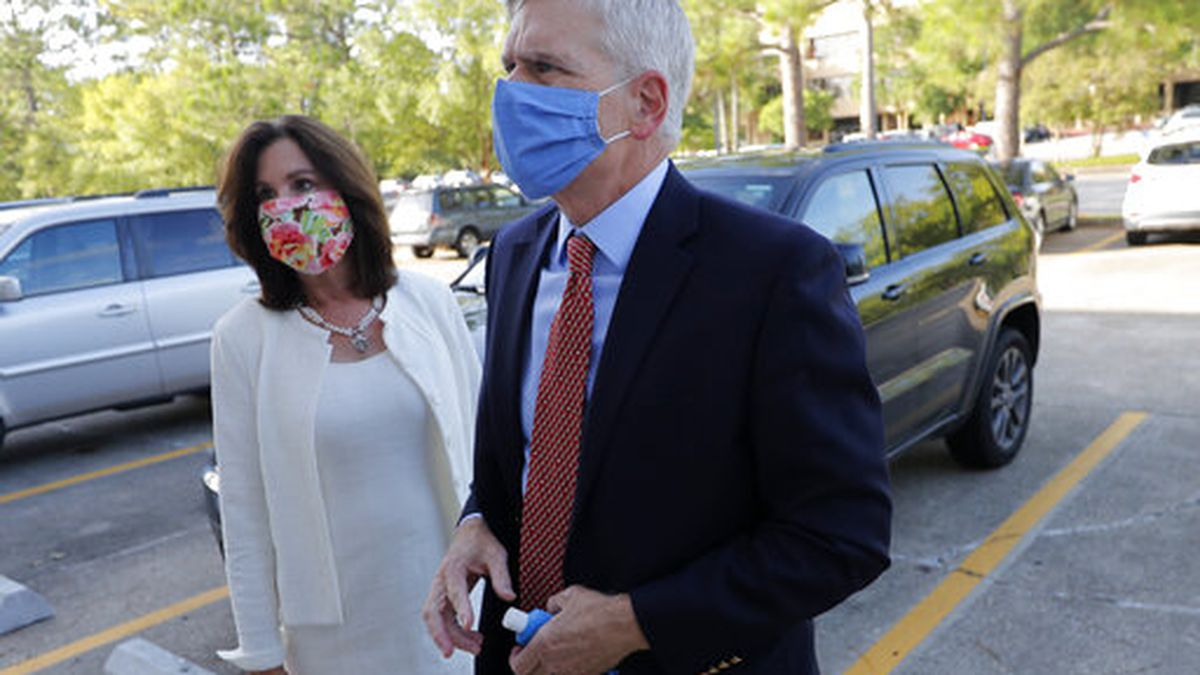 Sen. Bill Cassidy, R-La., arrives with his wife Laura at the office of the Secretary of State to register as a candidate to run as an incumbent in Baton Rouge, La., Friday, July 24, 2020. (AP Photo/Gerald Herbert)