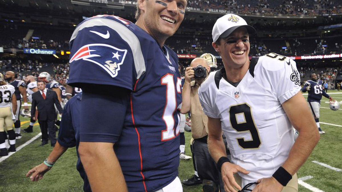 New England Patriots quarterback Tom Brady and New Orleans Saints quarterback Drew Brees greet...