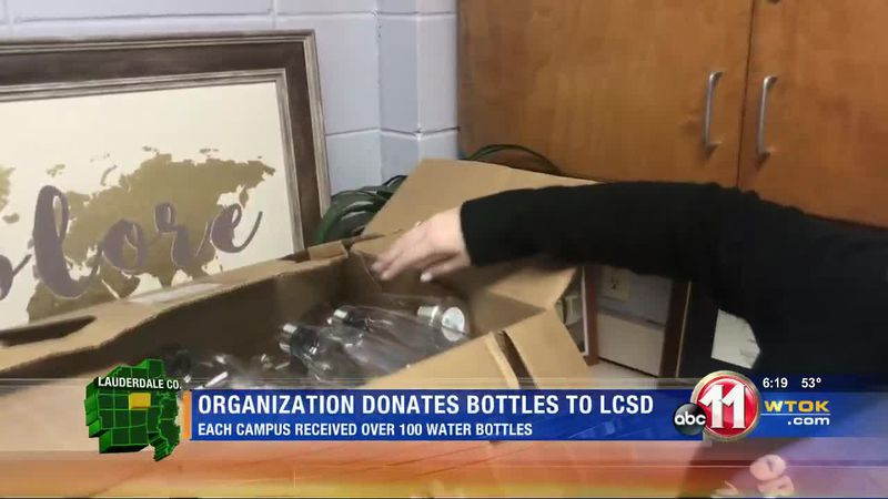 Junior Auxiliary of Meridian donates bottles to LCSD