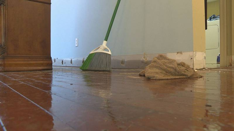 Cleanup begins for families affected by heavy rains.