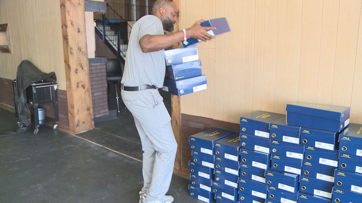 Coach Jazmin Mitchell of Sumter Central is giving away 115 pair of shoes to his local community.
