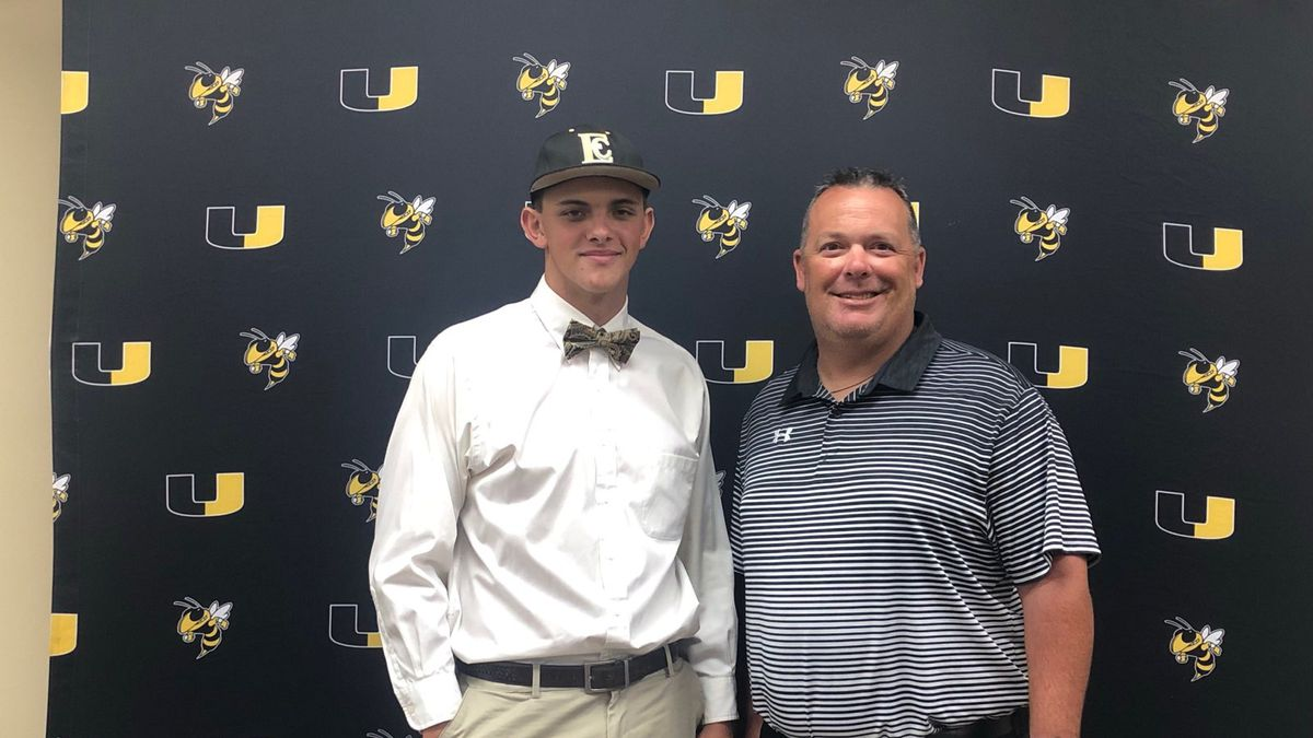 Union graduate JT Vance poses for a picture with baseball head coach Joey Ward. Vance signed to continue playing baseball at ECCC.