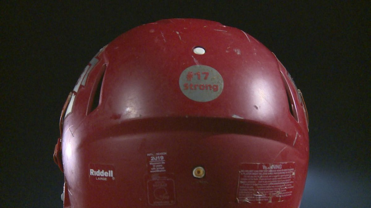 """The Trojans wore """"#17Strong"""" stickers on their helmets in honor of fallen teammate Corey Moss"""