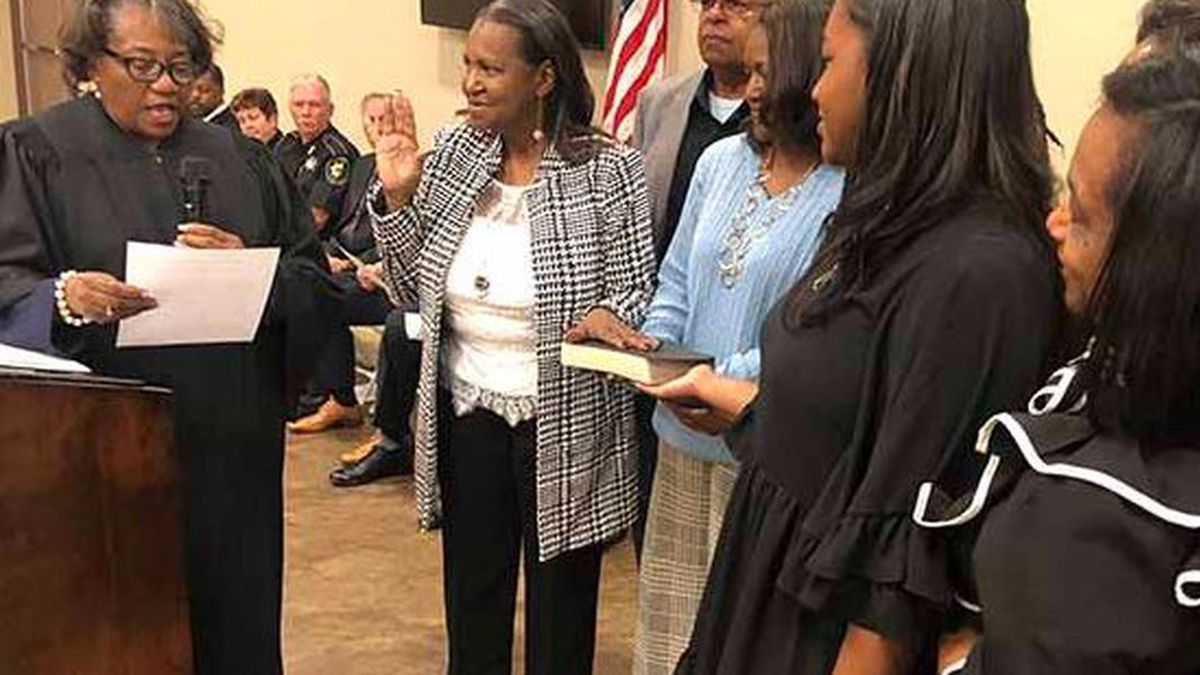 Rose Patterson, second from left, takes the oath of office in January 2020.