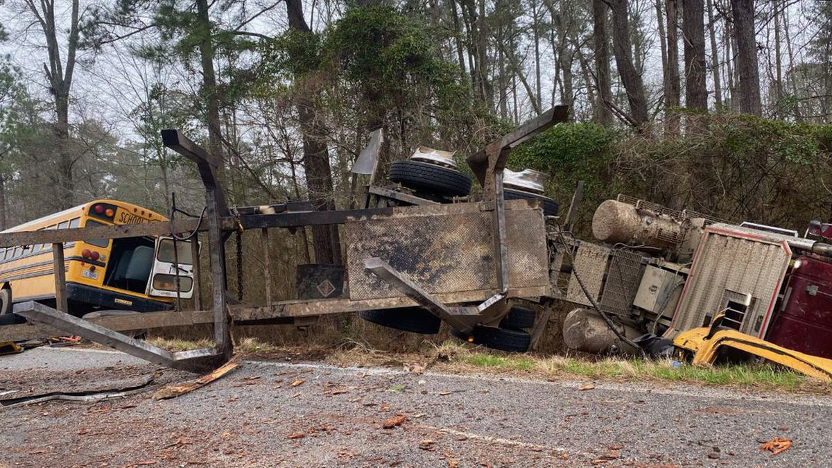 A log truck and a school bus were involved in a collision between Phillips Road East and Old...