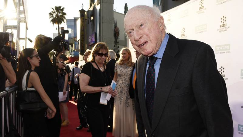 """Norman Lloyd poses before a 50th anniversary screening of the film """"The Sound of Music"""" at the..."""
