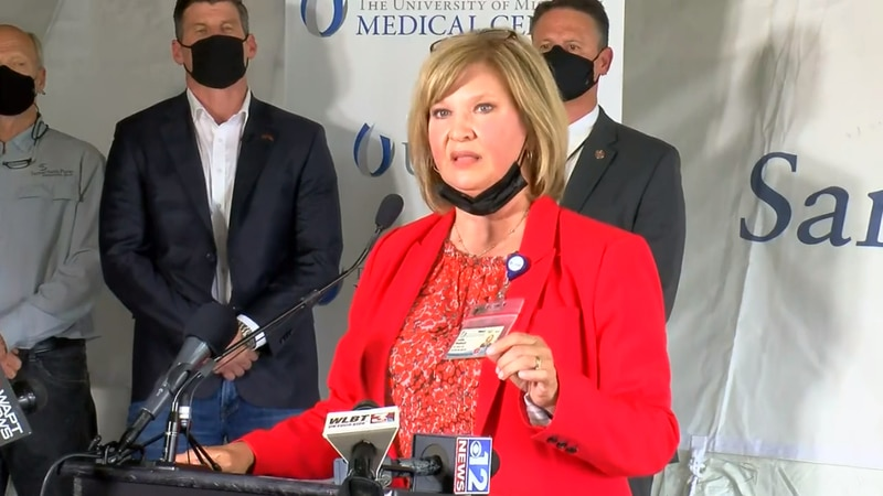 UMMC Vice-Chancellor Lou Ann Woodward speaks outside a second field hospital set up at UMMC to...
