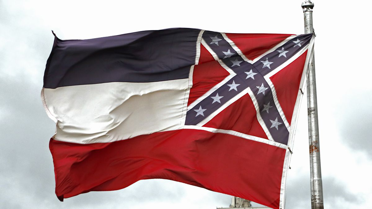 File-This June 25, 2020, file photo shows a Mississippi state flag flying outside the Capitol...