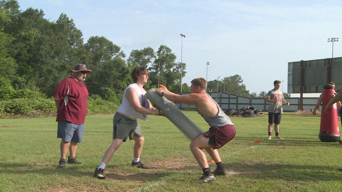 Clarkdale players go through lineman drills during voluntary summer workouts