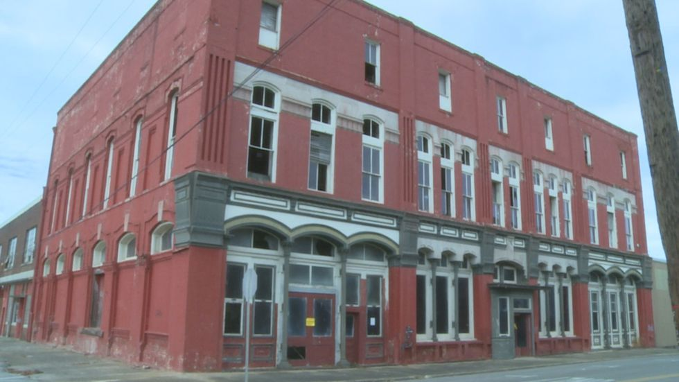 The red building on Front Street and 25th Avenue has been condemned but still stands.