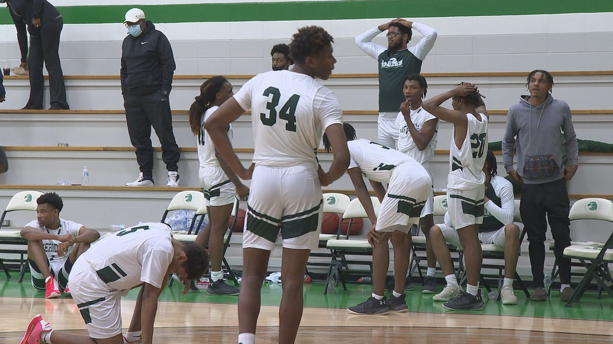Players from MCC's men's basketball team react after falling to Delgado by one point in the...