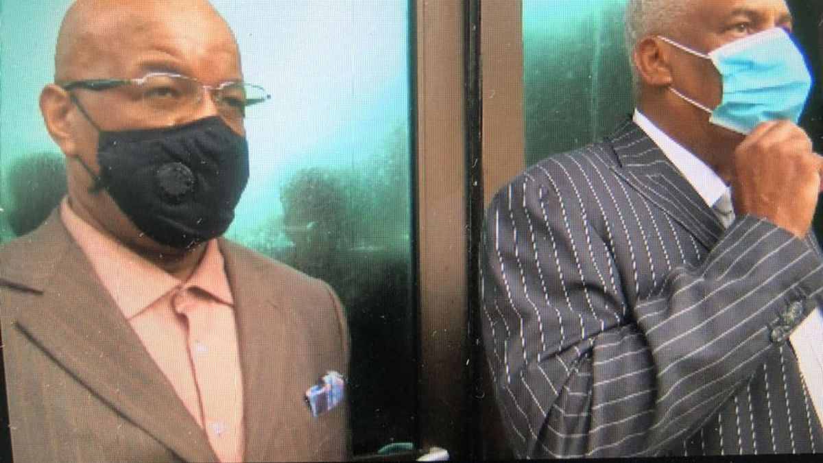 Dr. William Bynum and his lawyer, Dennis Sweet, leaving courtroom. (Source: WLBT)