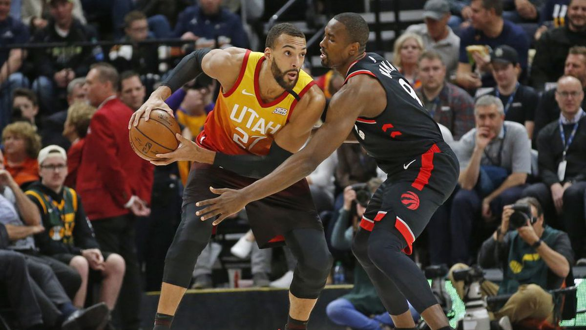 Toronto Raptors center Serge Ibaka (9) guards against Utah Jazz center Rudy Gobert (27) in the first half during an NBA basketball game Monday, March 9, 2020, in Salt Lake City. (AP Photo/Rick Bowmer)