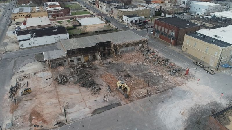 Two fire-damaged buildings demolished in downtown Meridian.