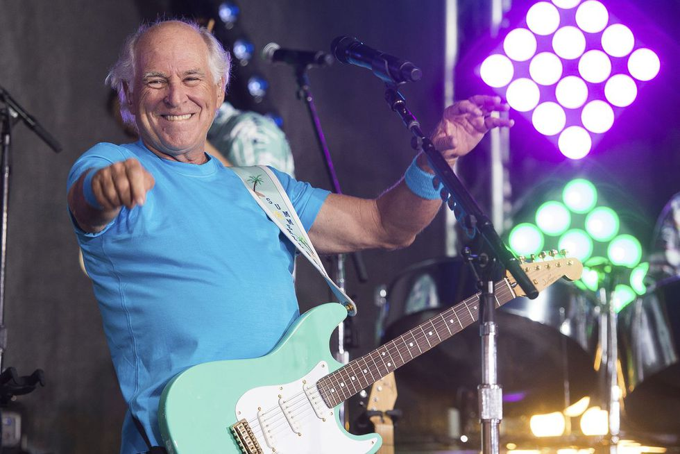 "FILE - This July 29, 2016 file photo shows Jimmy Buffett performing on NBC's ""Today"" show in New York. Buffett is opening a retirement village. Jimmy Buffett's Latitude Margaritaville will open its first community in Daytona Beach, Fla., in the fall. (Photo by Charles Sykes/Invision/AP, File)"