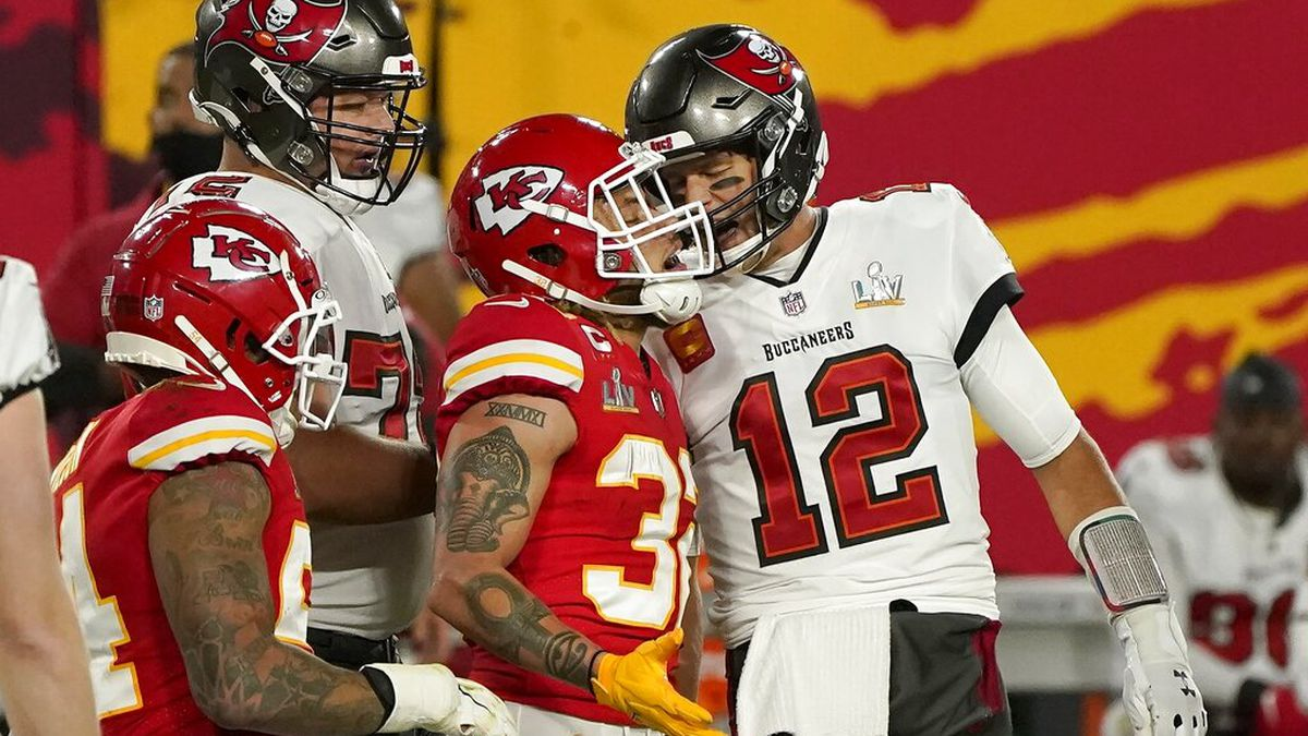 Tampa Bay Buccaneers quarterback Tom Brady (12) talks with Kansas City Chiefs strong safety...