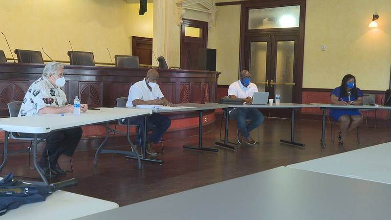 Councilmembers talk with appointees at work session.