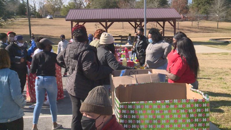 The Carter Foundation team helped distribute over 600 toys to young girls and boys.