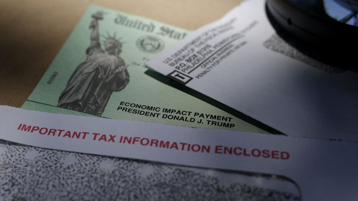 In this April 23, 2020, file photo, President Donald Trump's name is seen on a stimulus check...