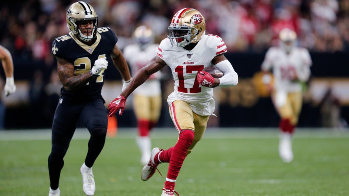 San Francisco 49ers wide receiver Emmanuel Sanders (17) carries against New Orleans Saints strong safety Vonn Bell (24) in the first half an NFL football game in New Orleans, Sunday, Dec. 8, 2019. (AP Photo/Brett Duke)