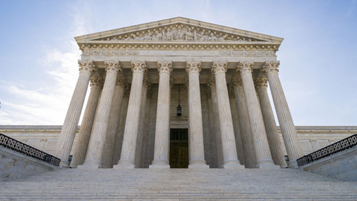 This June 17, 2019 file photo shows the Supreme Court in Washington. A divided Supreme Court is allowing the Trump administration to put in place a policy connecting the use of public benefits with whether immigrants could become permanent residents. (AP Photo/J. Scott Applewhite)