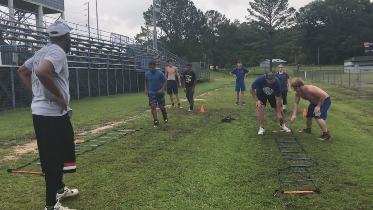 Southeast Lauderdale players complete ladder drills during voluntary summer workouts