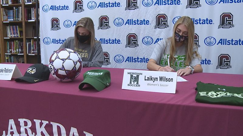 Clarkdale's, Brooke Robinson (left) and Laikyn Wilson (right) sign college letters of intent.