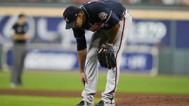 Atlanta Braves starting pitcher Charlie Morton rubs his leg before leaving the game during the...