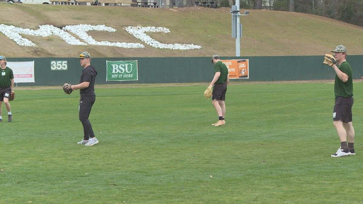 Players from MCC's baseball team warm up before practice
