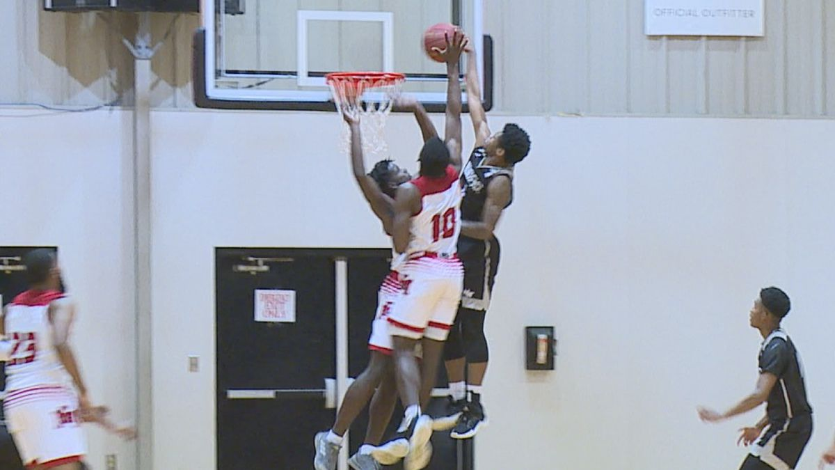 Jalin Rice of Northeast Miss. CC dunks on two EMCC defenders.