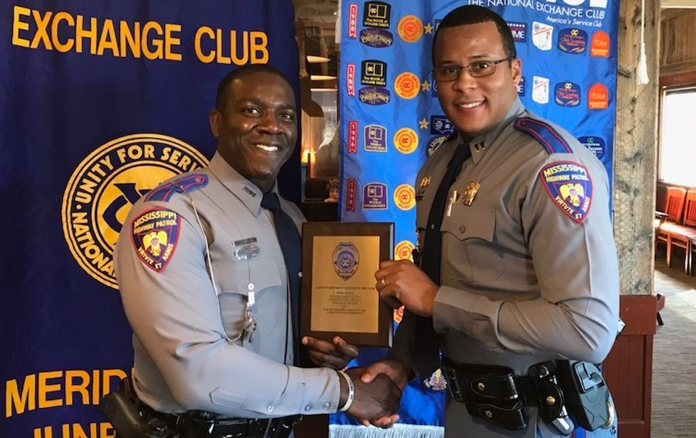 Capt. Brodrick Hutchins presents Trooper Derrick Qualls with the Trooper of the year Award.