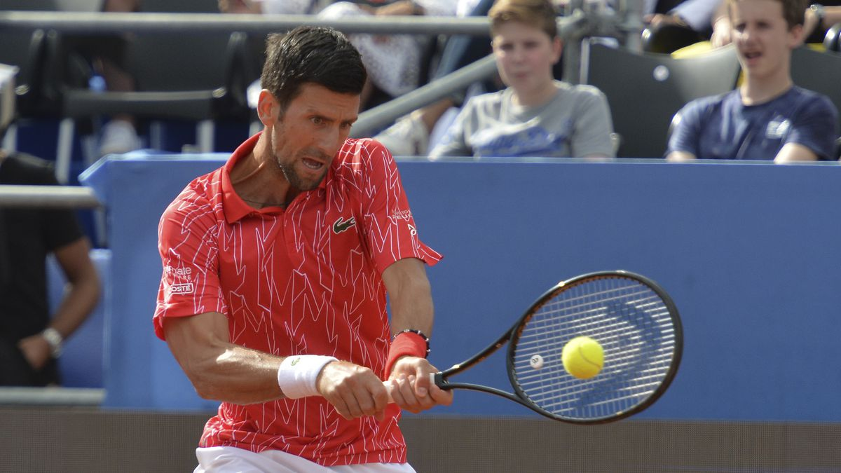 Serbia's Novak Djokovic returns the ball during an exhibition tournament in Zadar, Croatia, Sunday, June 21, 2020.