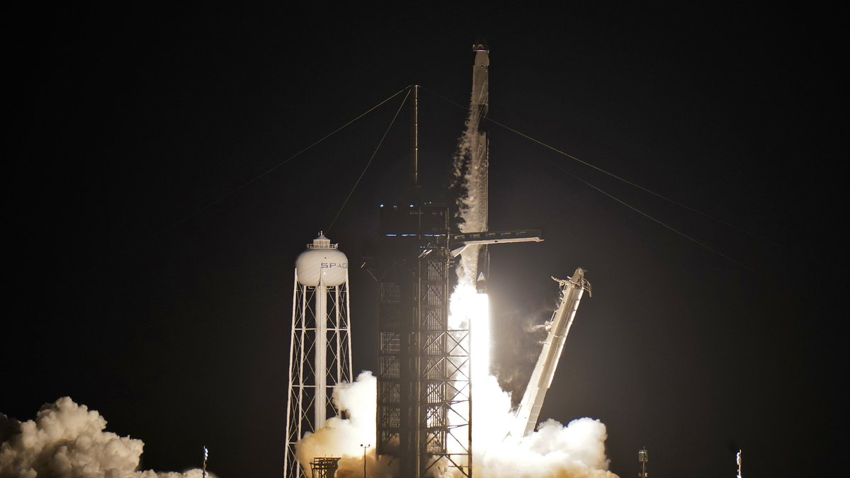 A SpaceX Falcon 9, with four private citizens onboard, lifts off from Kennedy Space Center's...